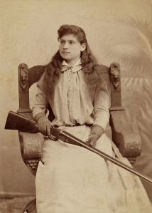 """Annie Oakley c1880"" by Baker Art Gallery - Heritage Auction Gallery. Licensed under Public domain via Wikimedia Commons - http://commons.wikimedia.org/wiki/File:Annie_Oakley_c1880.jpg#mediaviewer/File:Annie_Oakley_c1880.jpg"