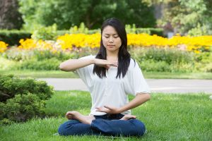 A woman performs the Falun Gong sitting meditation in a Toronto park, wikimedia Commons,http://commons.wikimedia.org/wiki/File:Toronto_Falun_Gong_Exercises_6.jpg